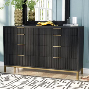 Dresser from AllModern in black with gold detailing and a large mirror above photo
