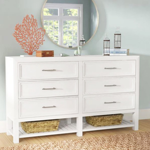 White dresser with silver handles and two open bottom shelves for storage baskets from Joss & Main photo