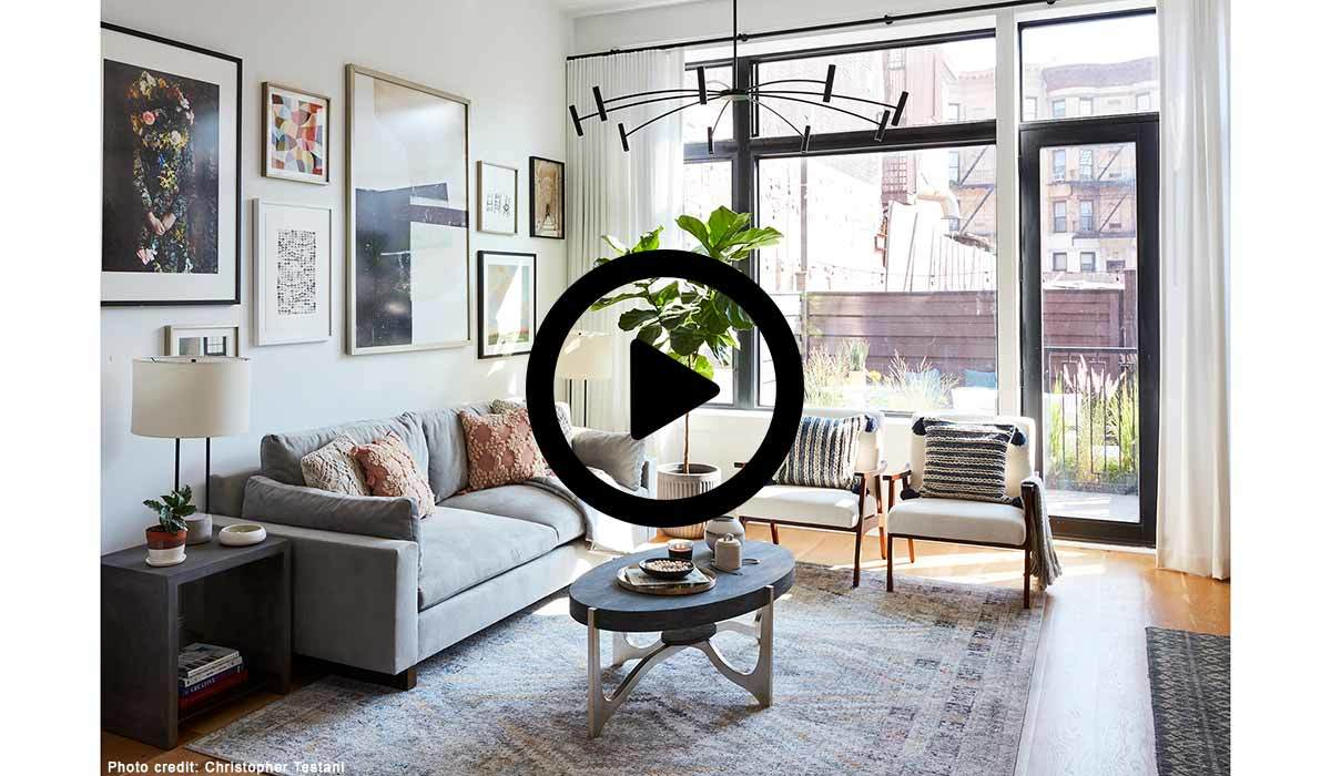 Living room with black play button in the center photo