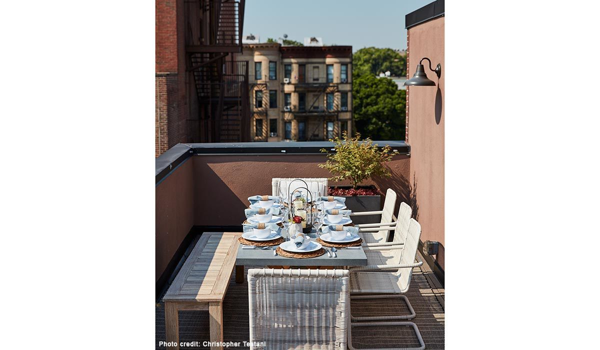 Outdoor dining space on a rooftop photo