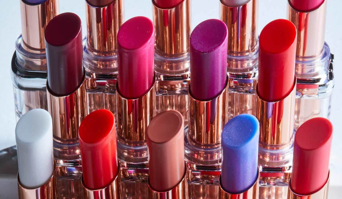 Multiple colors of lipstick in gold casing photo