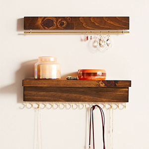 Two shelves with jewelry hanging from hooks photo