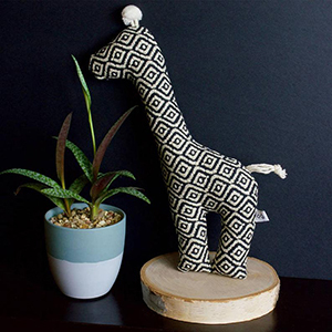 Black and white tribal patterned giraffe dog toy photo
