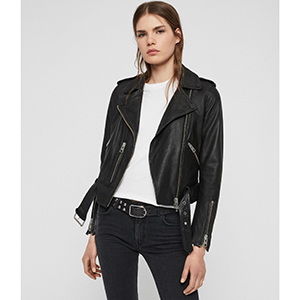 A woman wears a black leather jacket with a white t-shirt photo