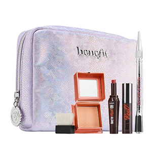 Metallic purple bag with makeup in front of it photo