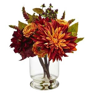 Polyester red and yellow flowers in a glass vase photo