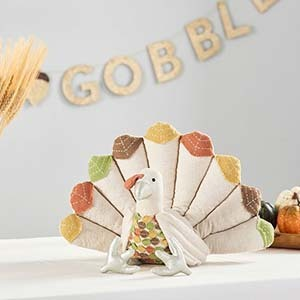 Cotton and linen turkey sitting on a table photo