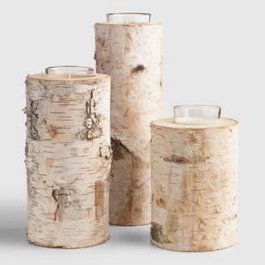 Birch wood candleholders with candles inside from World Market photo