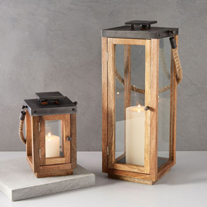 Wooden lanterns with rope handles and candles inside from West Elm photo