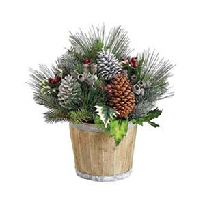 Artificial greenery, berries, and pinecones in a wood pot photo