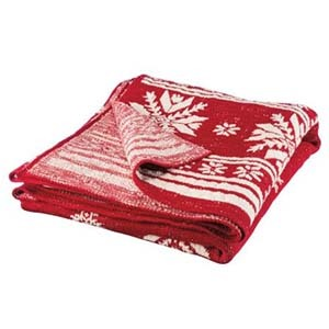 Red and white throw blanket with snowflake print photo