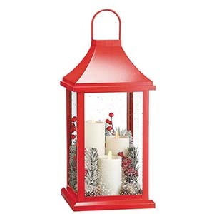 Red lantern with flameless candles and artificial ferns photo