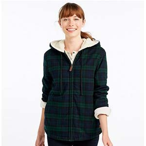 Woman wearing a green flannel zip-up shirt with fleece from L.L. Bean photo