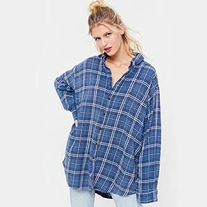 Girl wearing a blue oversized flannel from Urban Outfitters photo