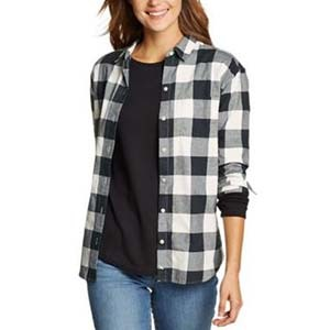 Woman wearing a black and white flannel and a black shirt photo
