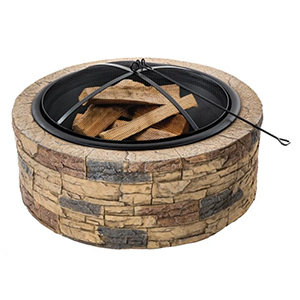 roundstone fire pit with mesh cover and poker with wood inside photo