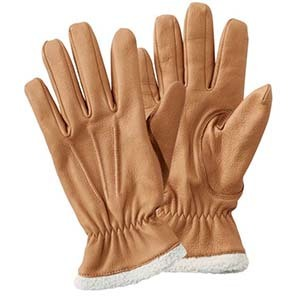 Tan leather gloves with white shearling cuff photo