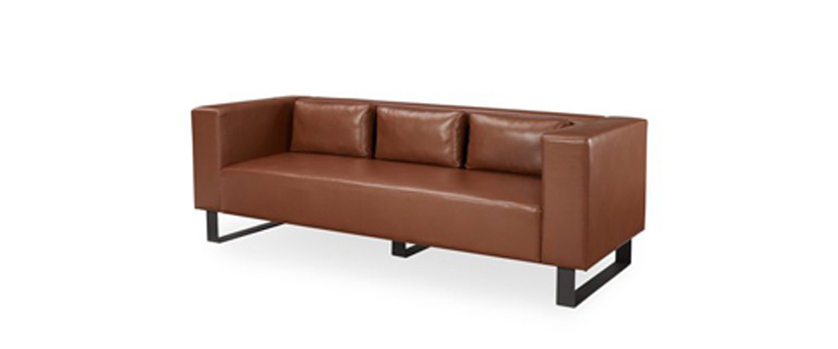 Caramel brown industrial sofa with metal base from Walmart photo