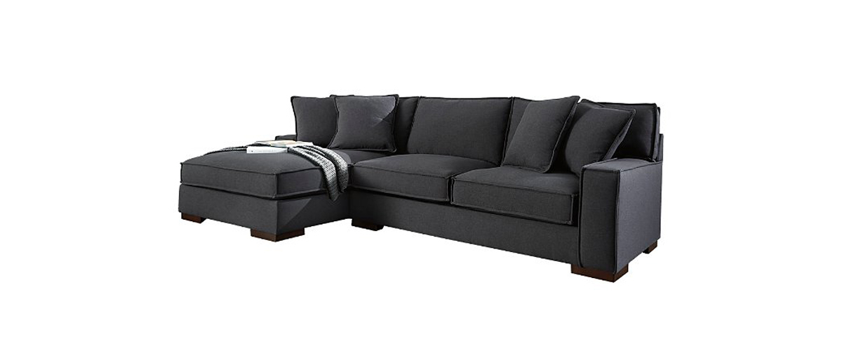 Dark gray sectional with blanket on the chaise from Ashley Homestore photo