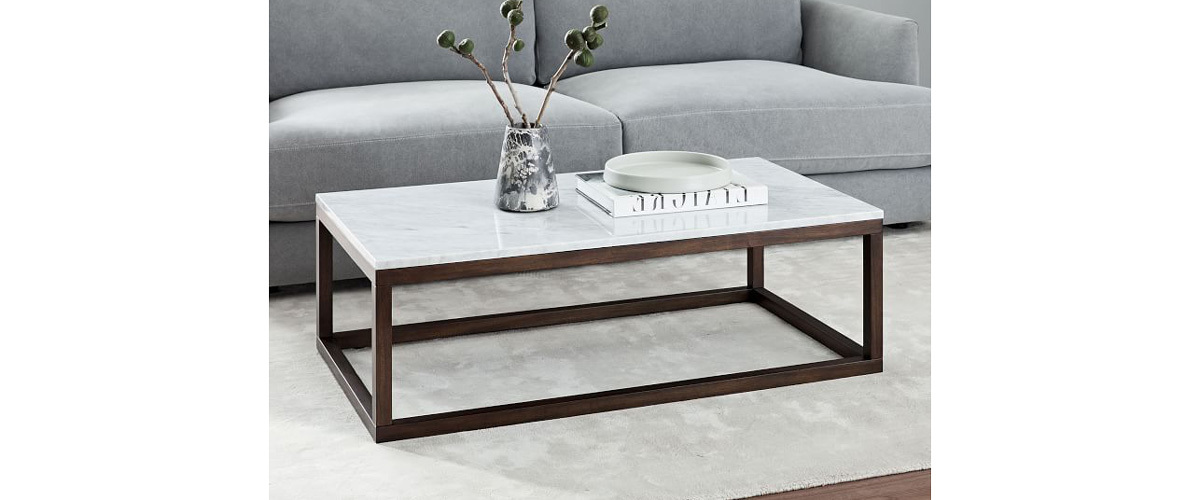 Coffee table with solid marble top and wood frame from West Elm photo