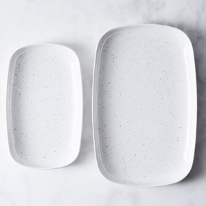 White speckled serving trays in two sizes from Food52 photo