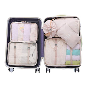 Packing organizer cubes filled with clothes in a suitcase from Amazon photo