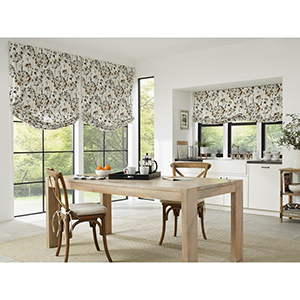 Kitchen or dining room with windows outfitted with premium roman shades from Blinds.com photo