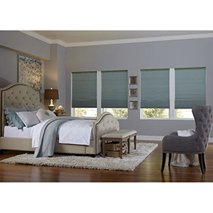 Bedroom with blue classic blackout cellular shades photo