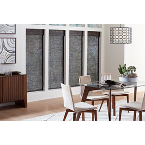 Dining room with dark woven wood shades from Blinds.com photo