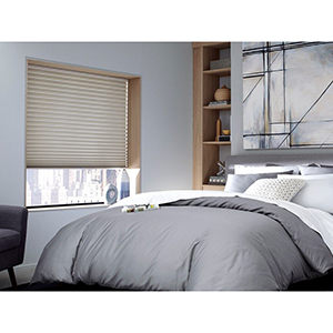 Bedroom with blackout cellular shades from Blinds.com photo