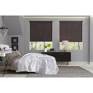 Bedroom with patterned blackout roller shades from Blinds.com photo