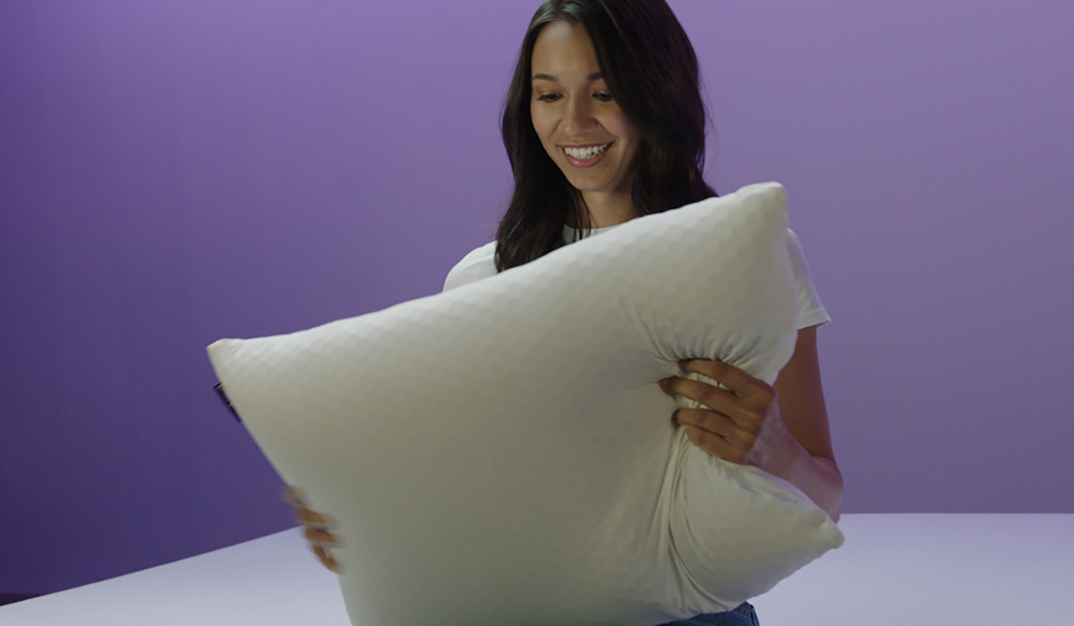 A woman holds a Purple Harmony Pillow photo
