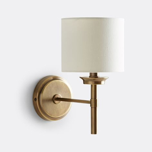 Bronze wall sconce with a white lamp shade from Pottery Barn photo