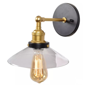 Gold wall sconce with a clear glass shade from Target photo