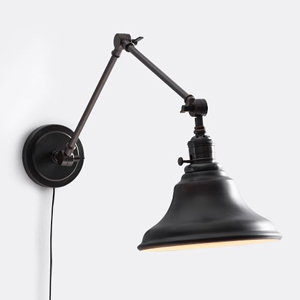 Black wall sconce with an articulating arm from Pottery Barn photo