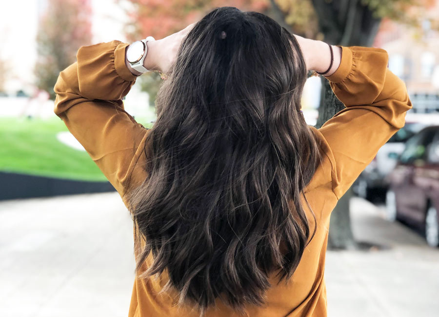 Carly's curled hair that's styled with Kristin Ess beauty products photo