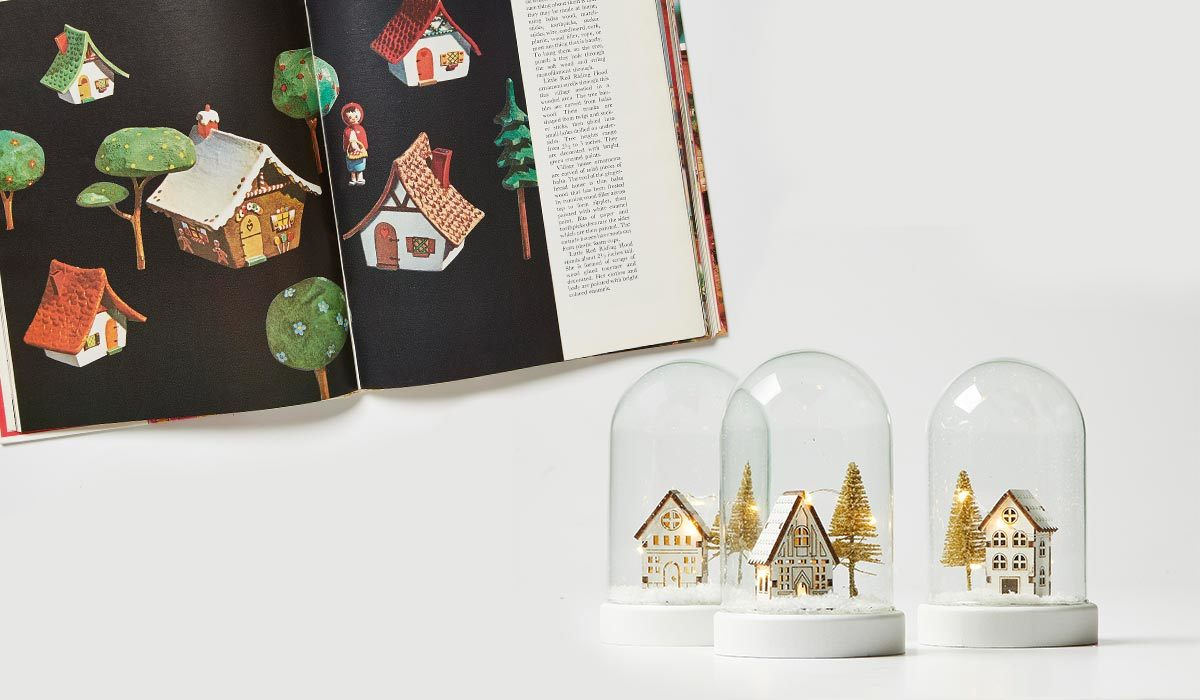 House snow globes next to a vintage Better Homes & Gardens magazine photo