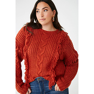 A woman wears a rust-colored fringed cableknit sweater from Forever 21 photo