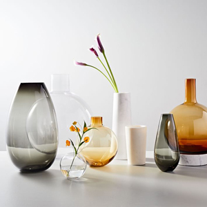Smoke gray, amber, and clear glass and marble vases from West Elm photo