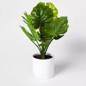 Artificial monstera plant in a white cylinder pot from Target photo