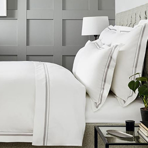 White Egyptian cotton bed sheets with beige trim from Nordstrom photo