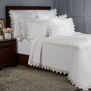 white sheet with scalloped embroidery from Bloomingdale's photo