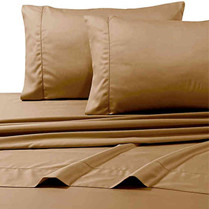 Cafe colored sheets on a bed and two pillows photo