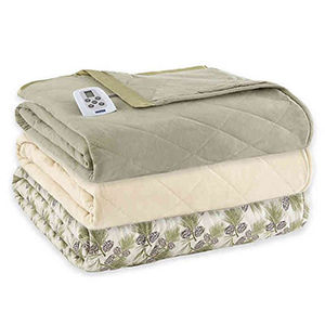 Green and cream colored stacked heated comforters from Bed Bath & Beyond photo
