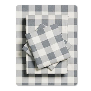 Patterned flannel sheets folded and stacked photo