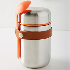 Orange and silver thermos with a small spoon from Anthropologie photo