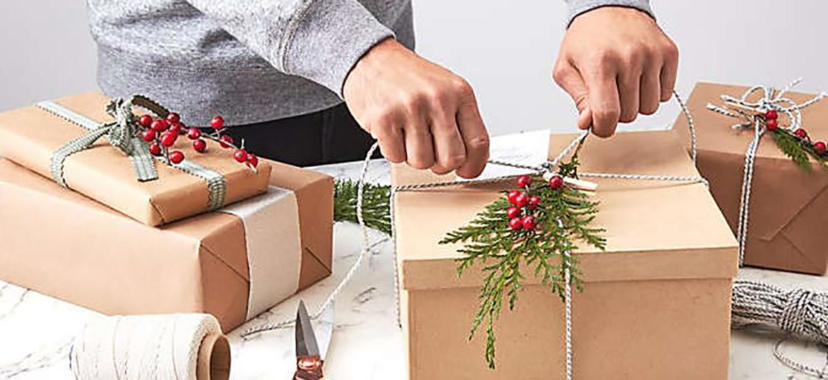 A person wraps holiday presents