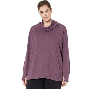 Woman wearing black pants and a purple sweatshirt from Zappos photo