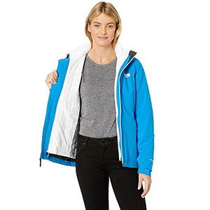 Woman wearing a North Face bright blue coat with a white liner from Zappos photo