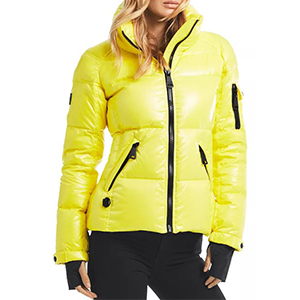 Woman wearing a neon yellow coat from Bloomingdale's photo